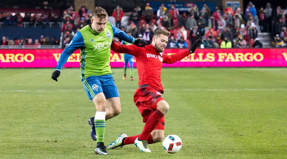 A ground battle between Toronto FC and Seattle Sounders. Image by Dennis Marciniak.