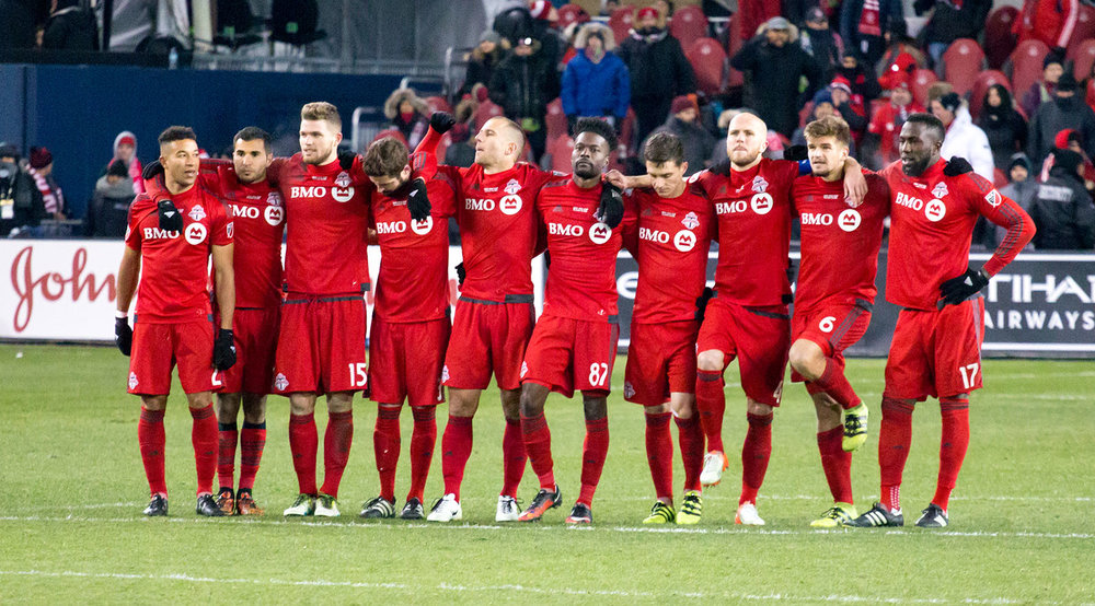 Toronto FC players await the first round of penalty kicks during the 2016 MLS Cup final at BMO Field on December 10, 2016. Image by Dennis Marciniak of denMAR Media.