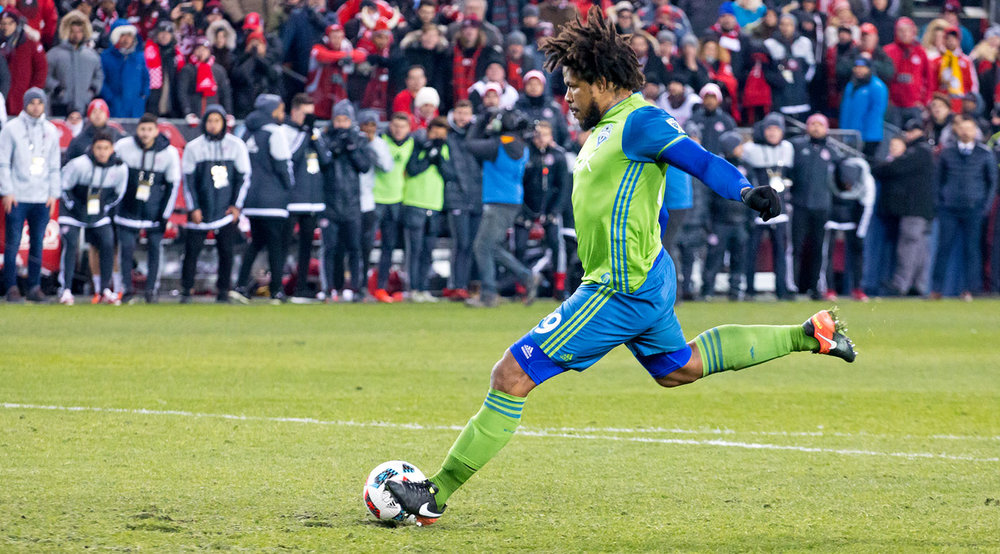Roman Torres about to kick the winning PK in the sixth round of penalties in the 2016 MLS Cup Final. Seattle would go on to win 5-4 on PKs. Image by Dennis Marciniak.