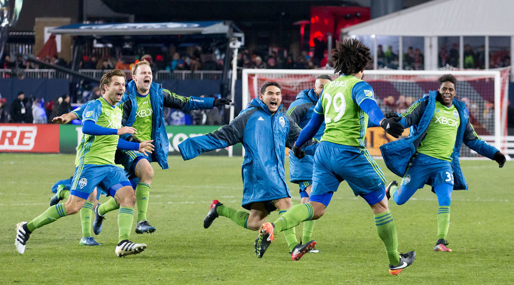 Roman Torres runs towards Seattle Sounders players after striking the winning PK to take home the 2016 MLS Cup back to Seattle. Image by Dennis Marciniak.