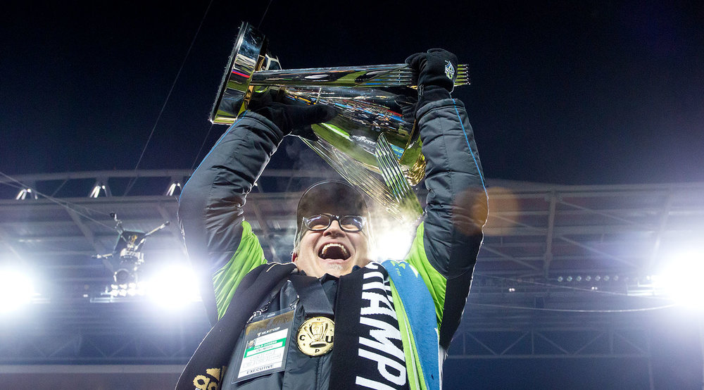 Drew Carey lifts the 2016 MLS Cup in celebration at BMO Field in Toronto, Canada. Image by Dennis Marciniak.