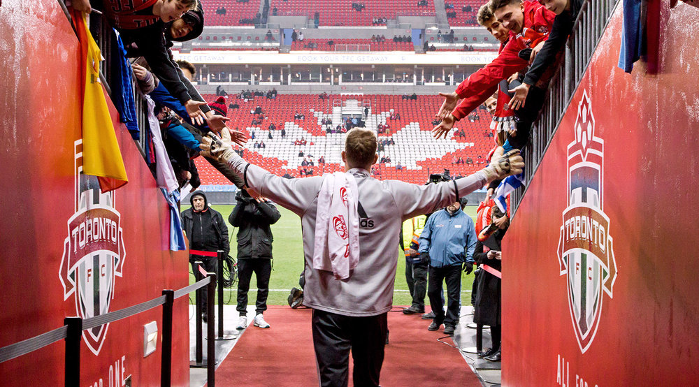 Clint Irwin coming out of the Toronto FC tunnel at BMO Field to greet young fans before a match in October 2016 against the NYCFC. Image by Dennis Marciniak.