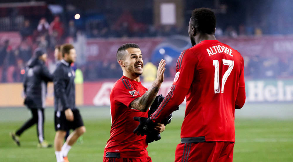Sebastian Giovinco and Jozy Altidore celebrate after a 2016 Toronto FC playoff match. Image by Dennis Marciniak of denMAR Media.