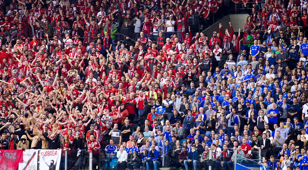 Red vs Blue at Montreal's Olympic Stadium during the first leg of the Eastern Conference Final in 2016. A sea of Toronto FC supporters vs Montreal Impact supporters. Image by Dennis Marciniak of denMAR Media.