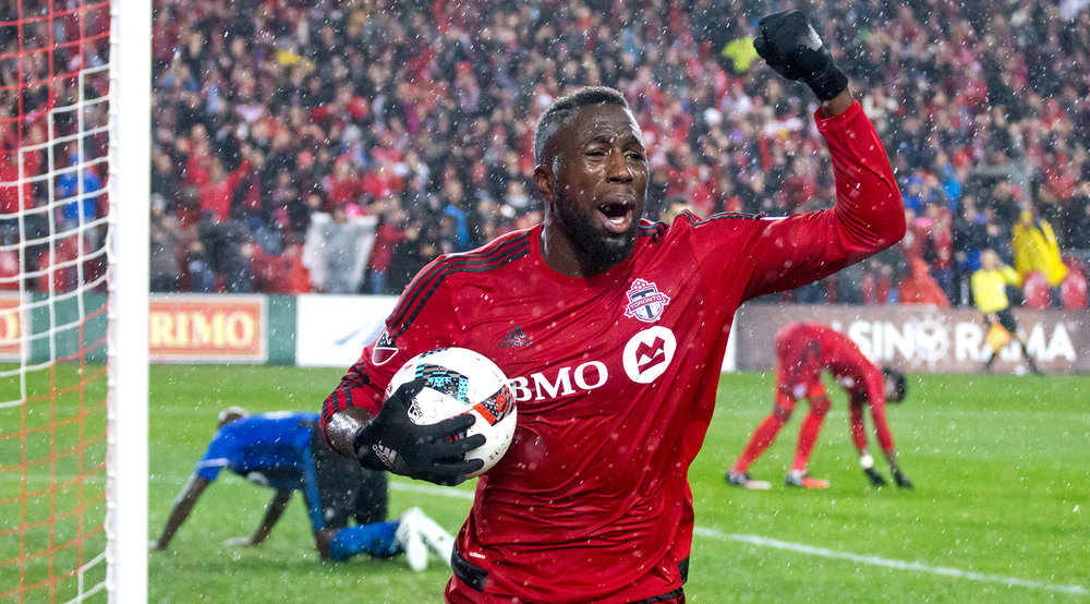 Jozy Altidore celebrates in the pouring rain after a spectacular goal. Image by Dennis Marciniak.