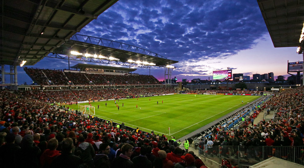 A beautiful sunsets overtakes BMO Field's skies on a crisp summer night in 2016. Toronto, Ontario. Image by Dennis Marciniak.