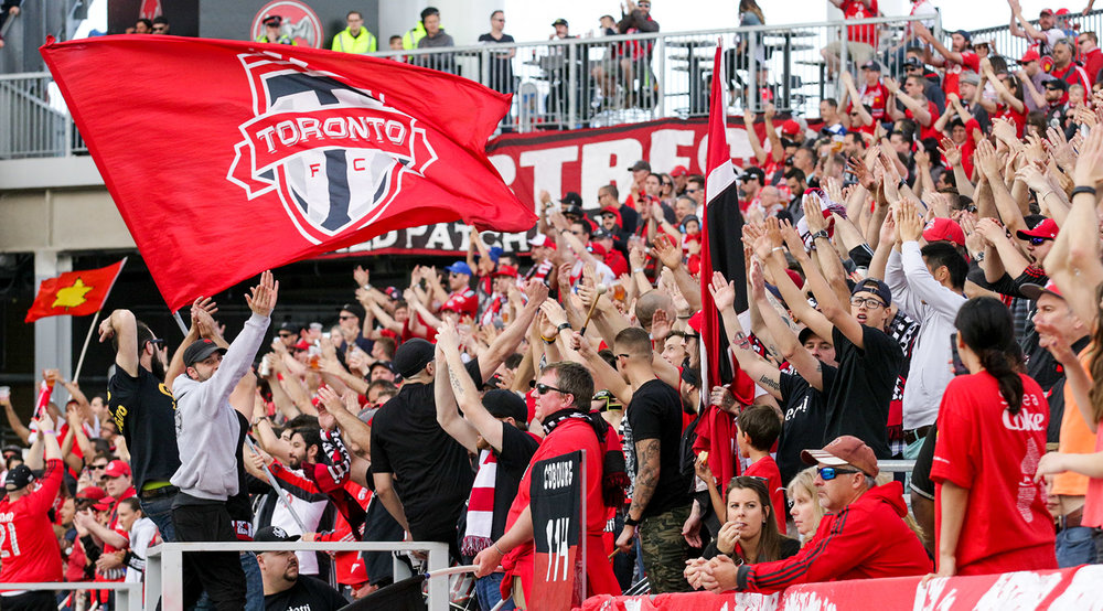 The South End Supporter's Section clapping in unison in 2016. Image by Dennis Marciniak.
