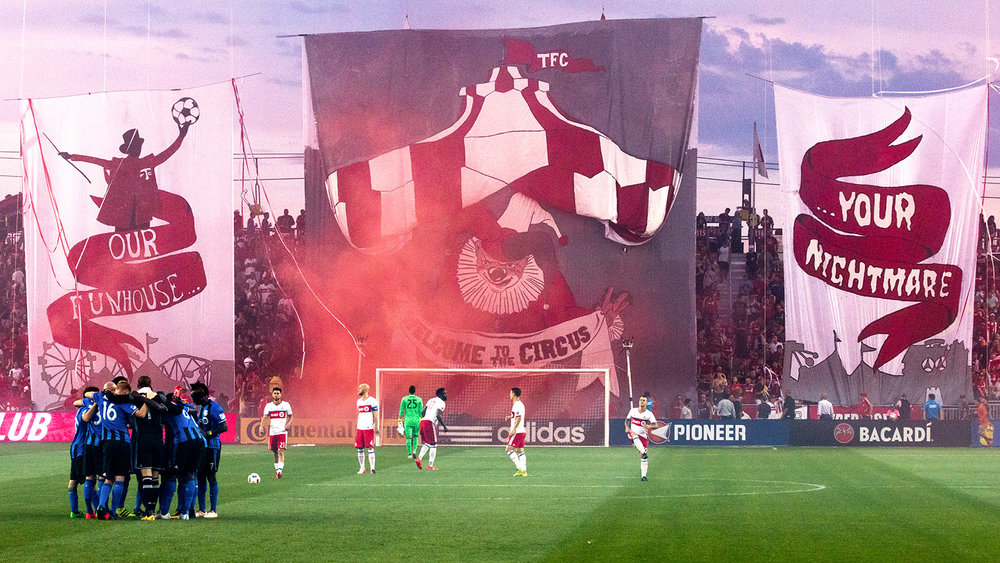 "The ""Our funhouse your nightmare - welcome to the circus"" Toronto FC TIFO at BMO Field on August 28, 2016. Image by Dennis Marciniak of denMAR Media."