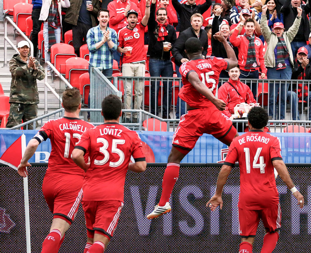 From May 28, 2014 when Doneil Henry celebrating a beauty of a header given by Daniel Lovitz. Dwayne De Rosario and Stephen Caldwell are also in frame celebrating. Image by Dennis Marciniak of denMAR Media.