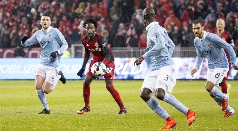 Tossaint Ricketts looks on as a ball is placed right in between him and a Sporting Kansas City players during the 2017 MLS Home Opener. Image by denMAR Media.