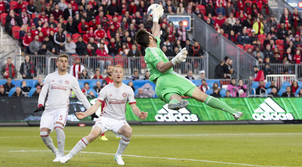 Atlanta United FC goalkeeper Alec Kann makes a massive save against Toronto FC on April 8, 2017. Image by Dennis Marciniak of denMAR Media.