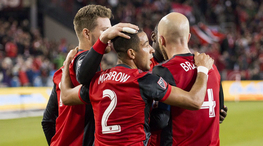 Justin Morrow celebrates his goal against Atlanta United FC with Michael Bradley at BMO FIeld on April 8, 2017. Image by Dennis Marciniak of denMAR Media.