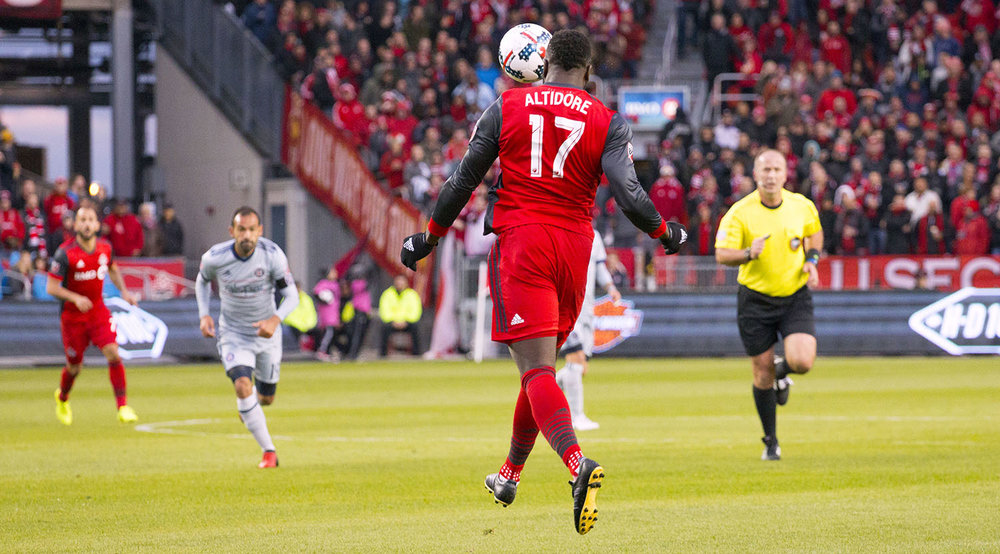 Jozy Altidore goes for a defensive header during a Major League Soccer match in 2017. Image by Dennis Marciniak.