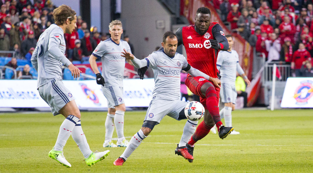 Jozy Altidore challenged the ball from a Chicago Fire defender in a MLS Match in 2017. Image by Dennis Marciniak of denMAR Media.