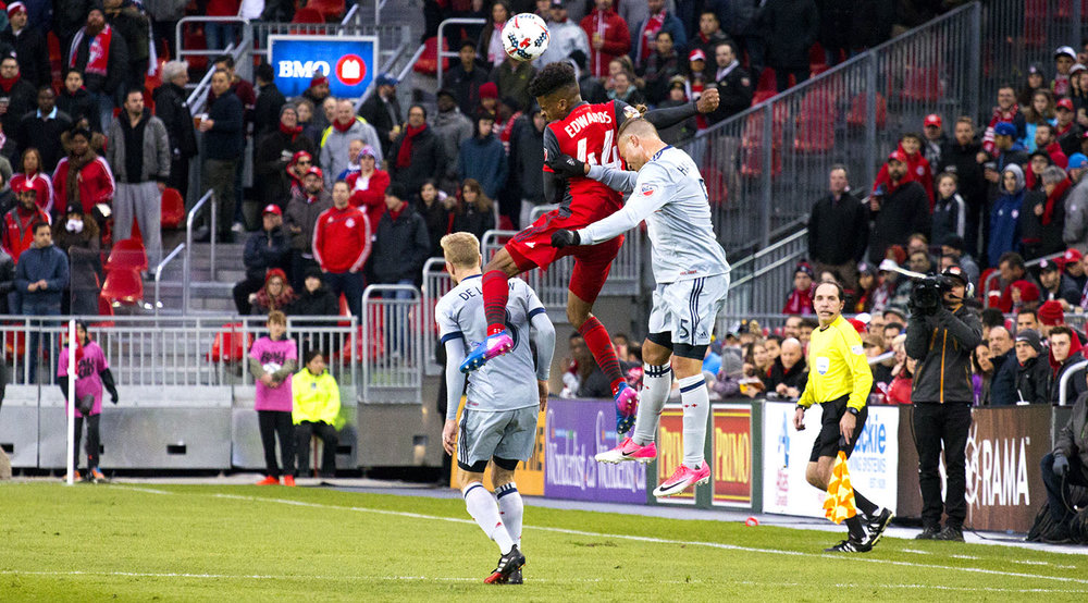 Raheem Edwards flies through the air to get a head on the ball during a Major League Soccer match against the Chicago Fire in 2017. Image by Dennis Marciniak of denMAR Media.