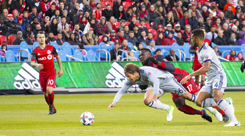 Jozy goes to ground with Joao Meira during a MLS match in 2017. Image by Dennis Marciniak of denMAR Media.