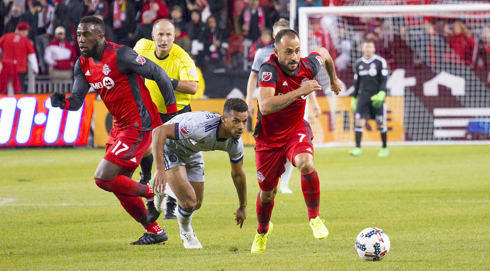 Víctor Vázquez gets the ball away from a Chicago Fire defender. Image by Dennis Marciniak of denMAR Media.
