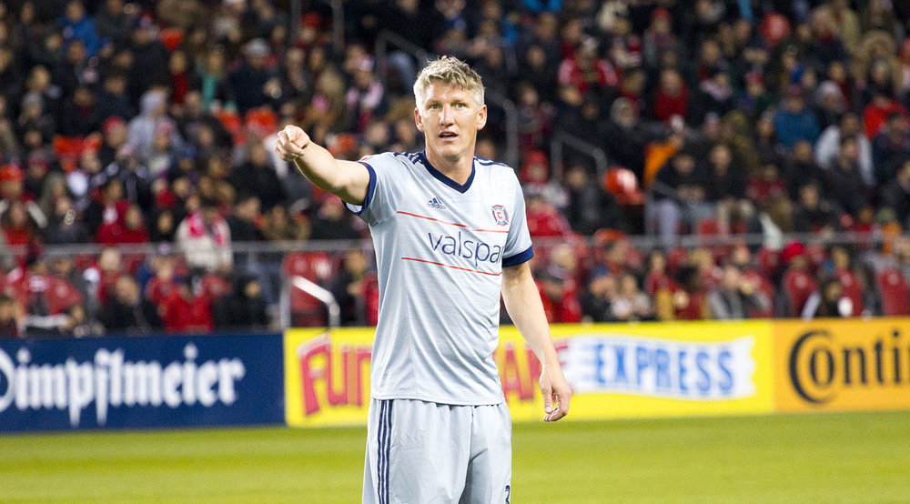 Bastian Schweinsteiger directing his Chiacgo Fire teammates during a Major League Soccer match in Toronto, Canada. Image by Dennis Marciniak of denMAR Media.