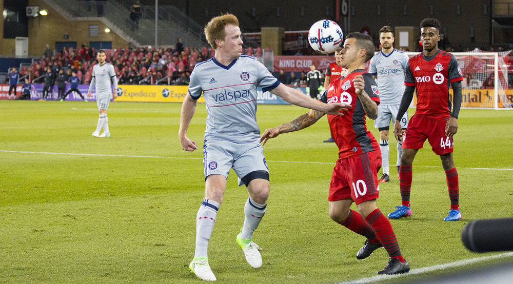 Sebastian Giovinco get a head on the ball during a MLS match against Chiacgo Fire in Toronto, Ontario. Image by Dennis Marciniak of denMAR Media.