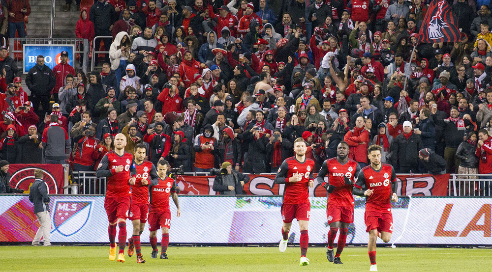 Toronto FC celebrate a third goal to make it 3-1 on the night against the Chicago Fire. Image by Dennis Marciniak of denMAR Media.
