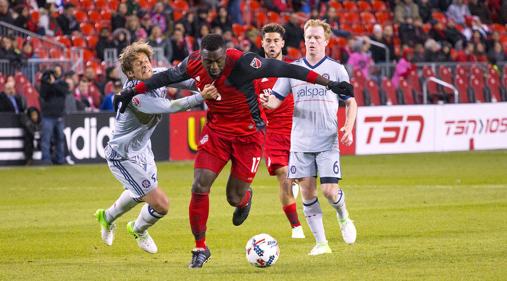 Jozy Altidore has his shirt tugged on during a play in the Chicago Fire box at BMO Field. Image by Dennis Marciniak.
