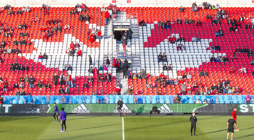The Canadian Maple Leaf in the stands at BMO FIeld as fans file in to watch the pregame practices for Toronto FC v Orlando City SC in 2017. Image by Dennis Marciniak of denMAR Media.
