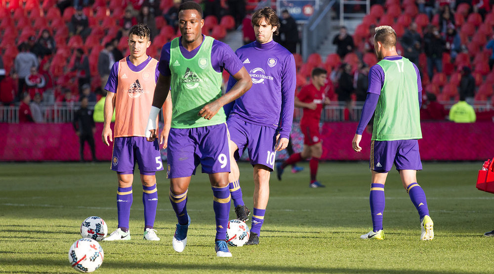 Orlando CIty SC's Cyle Larin and Ricardo Kaká do their pregame warm ups on an away trip at BMO Field to face Toronto FC in a regular season game in 2017. Image by Dennis Marciniak of denMAR Media.