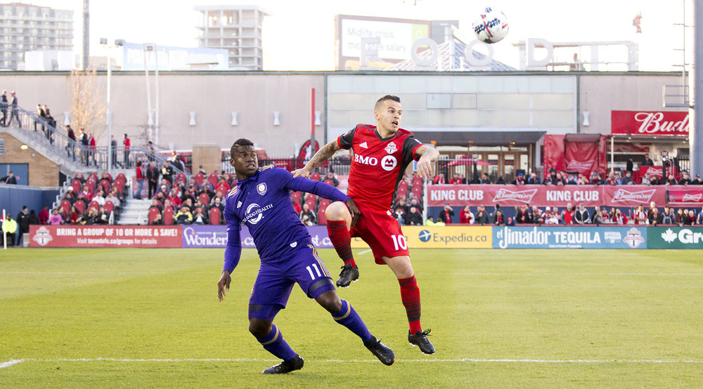 Sebastian Giovinco looks for the ball in the air in the first half of play of a regular seasons Major League Soccer game in 2017. Image by Dennis Marciniak of denMAR Phtoography.