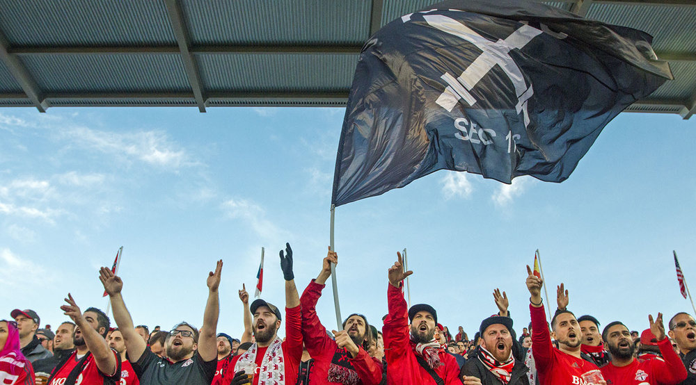 South End supporters wave the Kings of the North flag high above the stands at a regualr season Major League Soccer game in 2017. Image by Dennis Marciniak of denMAR Photography.