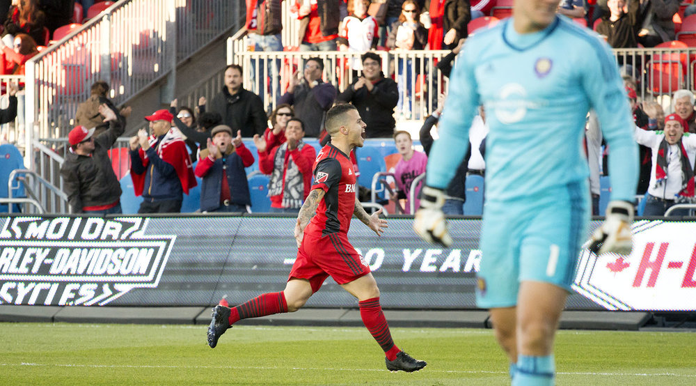 Joe Bendik in the foreground disappointed by Sebastian Giovinco's great goal in the first half. Image by Dennis Marciniak of denMAR Photography.
