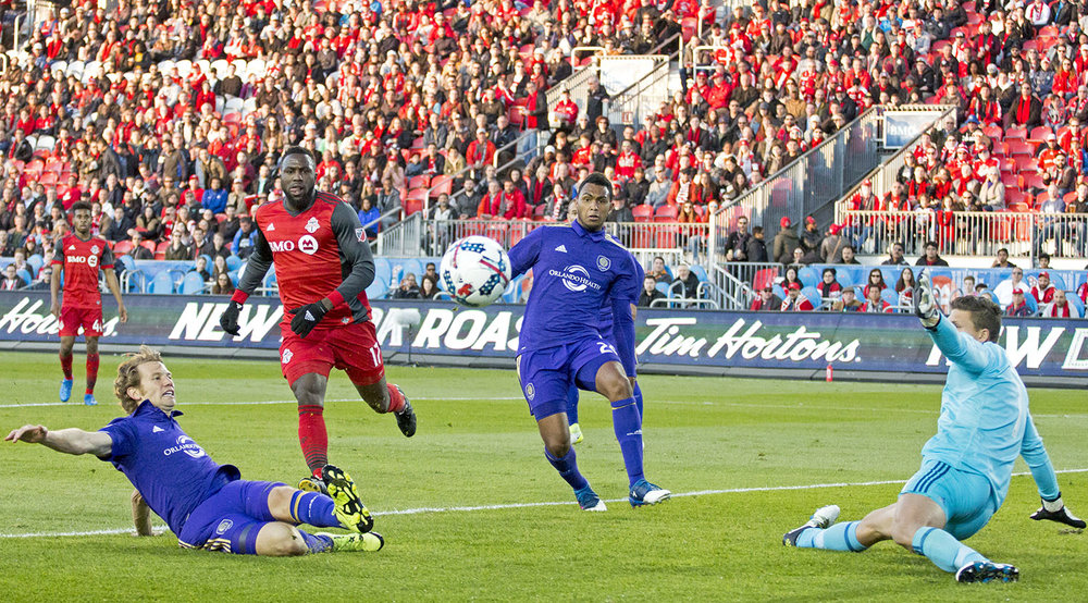 Jozy Altidore and Joe Bendik look towards the ball as it goes out of play and towards the camera person. Image by Dennis Marciniak of denMAR Media.