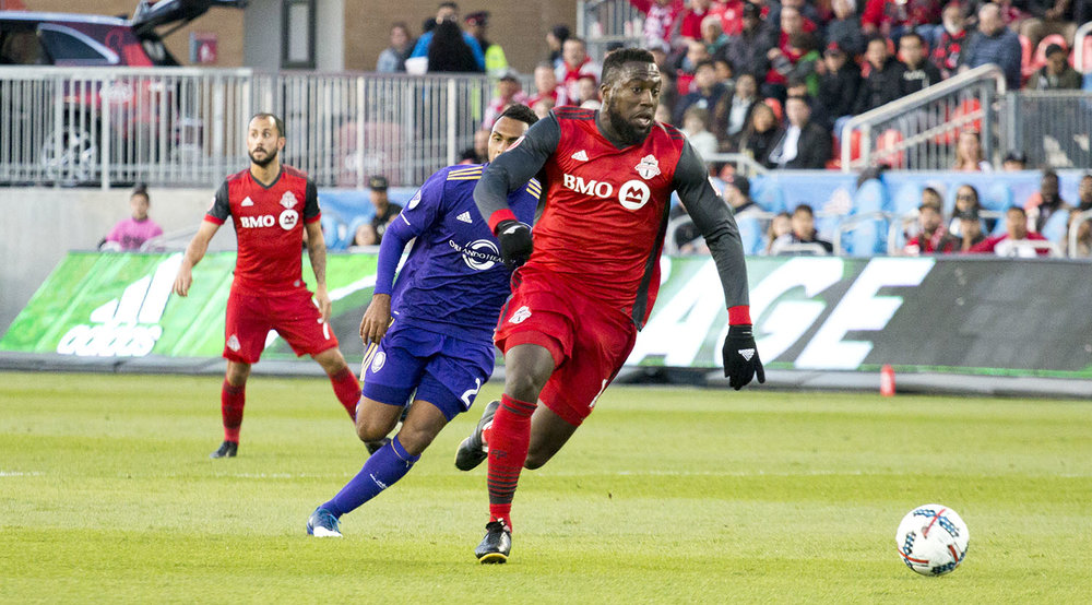 Jozy Altidore runs towards the ball as it breaks free in the south end of BMO Field at a Toronto FC game in 2017. Image by Dennis Marciniak of denMAR Media.