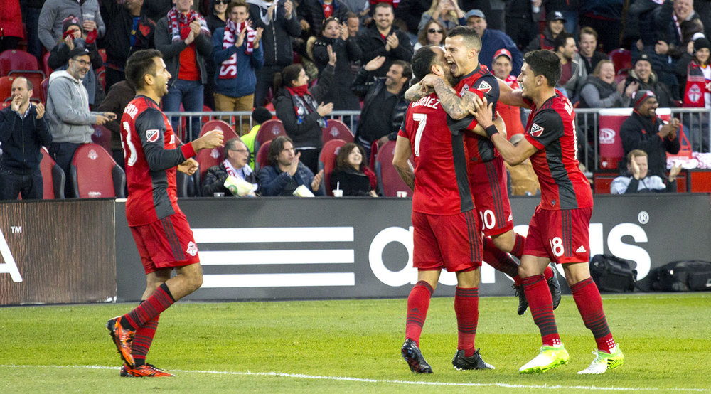 Sebastian Giovinco celebrates his 2nd goal on the night with Víctor Vázquez Solsona in the south end of BMO Field in 2017. Image by Dennis Marciniak of denMAR Media.