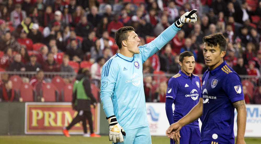 Foremer Toronto FC goalkeeper and current Orlando City SC goalkeeper Joe Bendik irate at his back line after the Sebastian Giovinco goal at a regular season match in 2017. Image by Dennis Marciniak off denMAR Media.