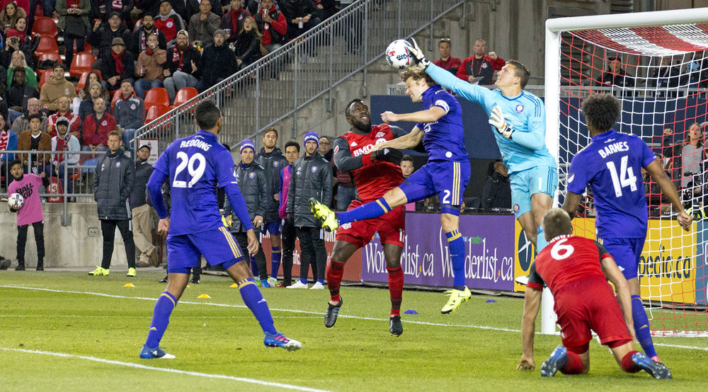 Joe Bendik makes a clutch save with the glove to keep Toronto FC from getting another change in the 18 yard box. Image by Dennis Marciniak of denMAR Media.