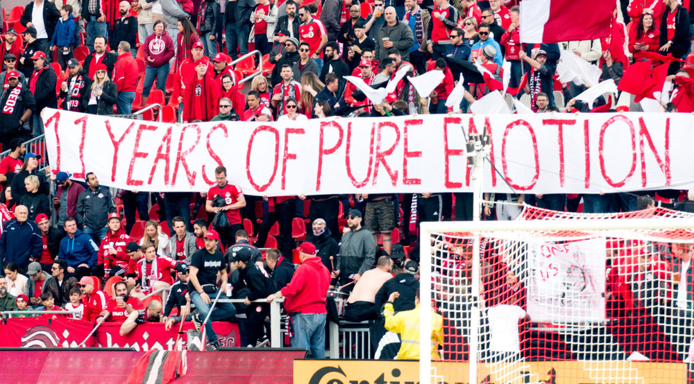 The '11 Years of Pure Emotion' banner is displayed in the South End Supporters Section at BMO Field. Image by Dennis Marciniak of denMAR Media.