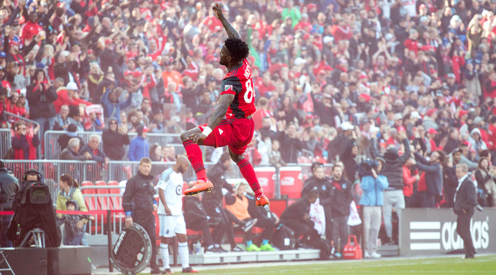 Tosaint Ricketts soaring through the air in celebration after a beautiful header to take Toronto FC to 3 goals and the win over Minnesota United FC. Image by Dennis Marciniak of denMAR Media.