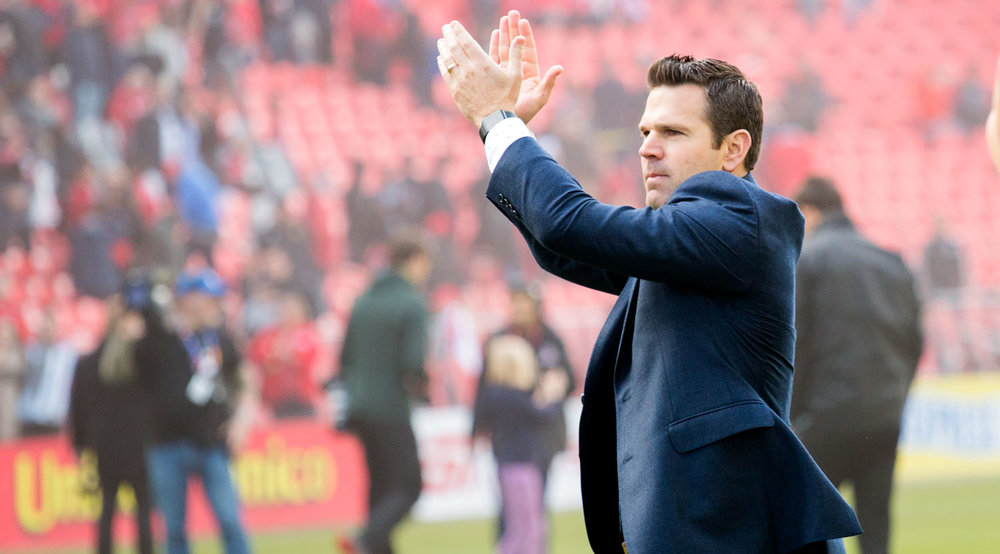 Greg Vanney clapping towards the south end fans after a vicotry over Minnesota United at BMO Field. Image by Dennis Marciniak of denMAR Media.