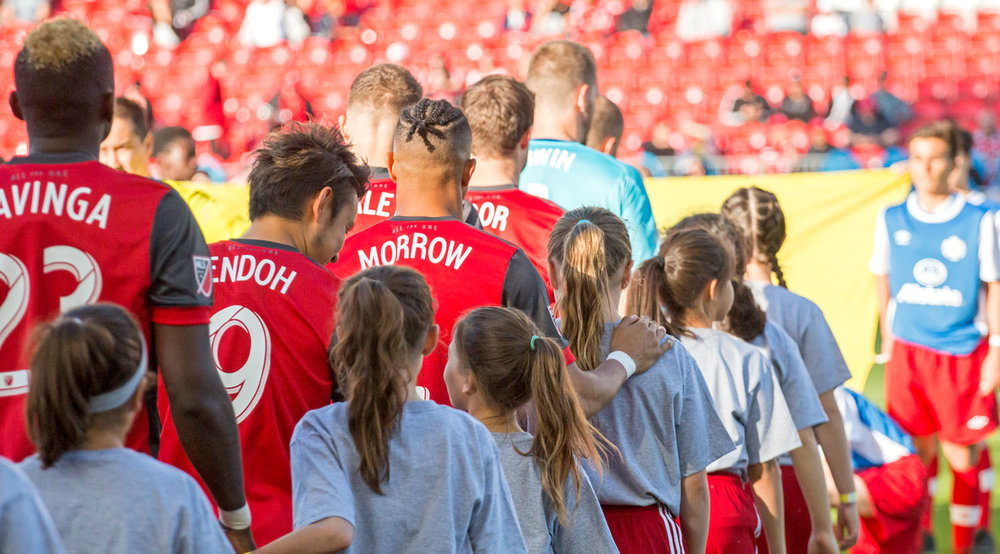 Justin Morrow heads out with player escort during the Toronto FC game against the Ottawa Fury at BMO Field in 2017. Image by Dennis Marciniak of denMAR Media.