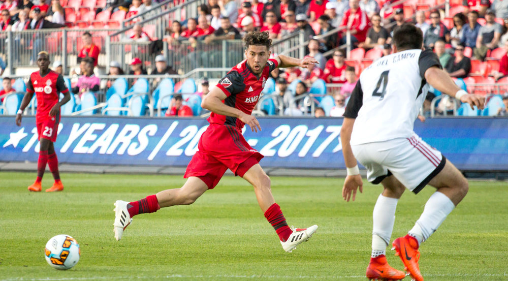 Jonathan Osorio looks at the ball as it rolls down the field and tried to get into position in front of the opposition's net. Image by Dennis Marciniak of denMAR Media.