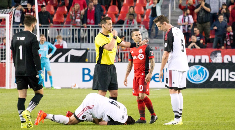 Sebastian Giovinco in disbelief that an opposing Ottawa Fury player went down over his light push at midfield. Image by Dennis Marciniak of denMAR Media.