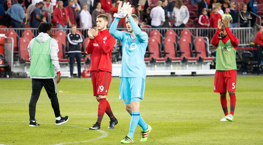 Clint Irwin (with the clean sheet) thanks the south end supporter's section after the conclusion of a Toronto FC match in which the team would score 4 goals. Image by Dennis Marciniak of denMAR Media.