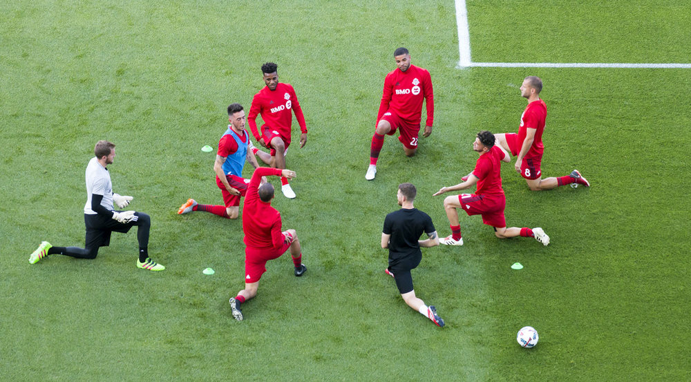 Toronto FC doing their pregame stretches before an Major League Soccer match in 2017. Image by Dennis Marciniak of denMAR Media.