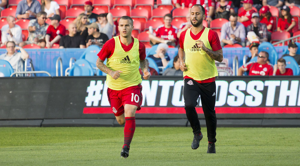 Sebastian Giovinco and Víctor Vázquez Solsona go about their training before a Major League Soccer match in 2017. Image by Dennis Marciniak of denMAR Media.