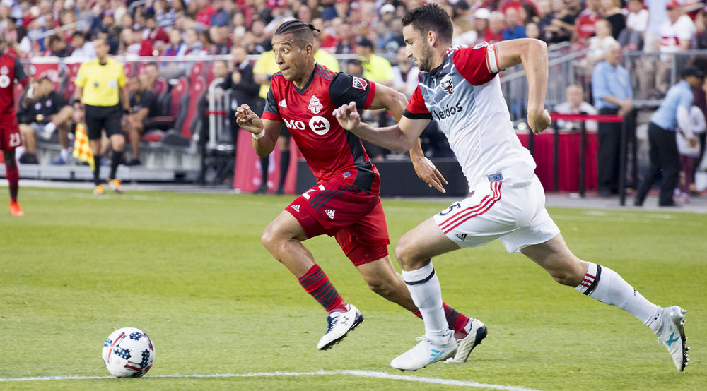Justin Morrow trying to play the ball into space during a match against DC United in June 2017. Image by Dennis Marciniak of denMAR Media.