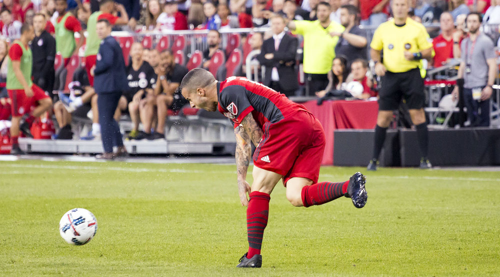 Sebastian Giovinco slams the ball into the ground during a match against DC United in 2017. Image by Dennis Marciniak of denMAR Media.