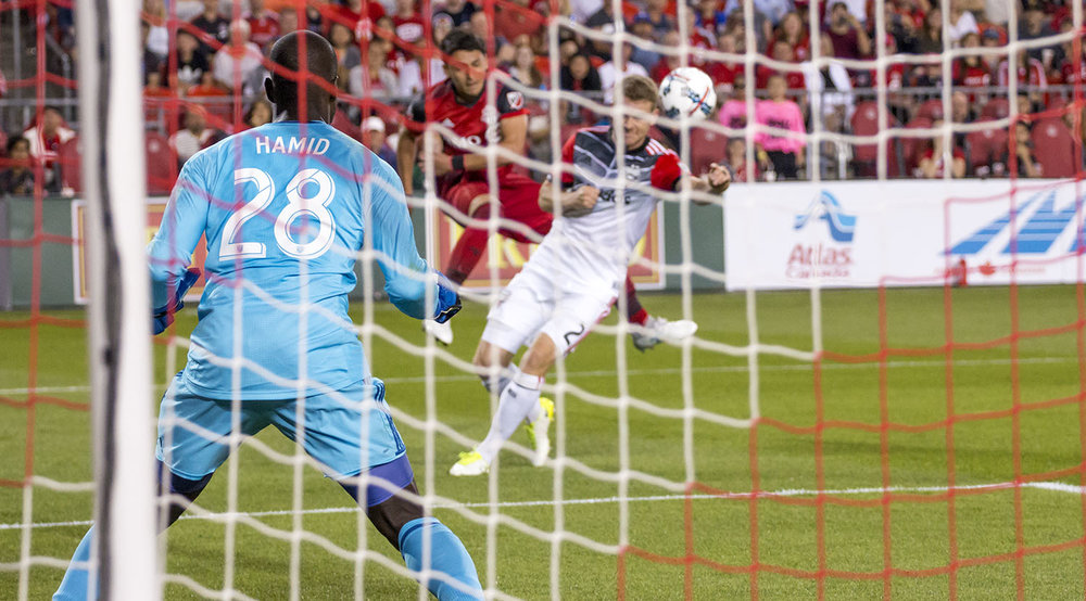 DC United's Bill Hamid trying to track the ball coming across the box. Image by Dennis Marciniak of denMAR Media.