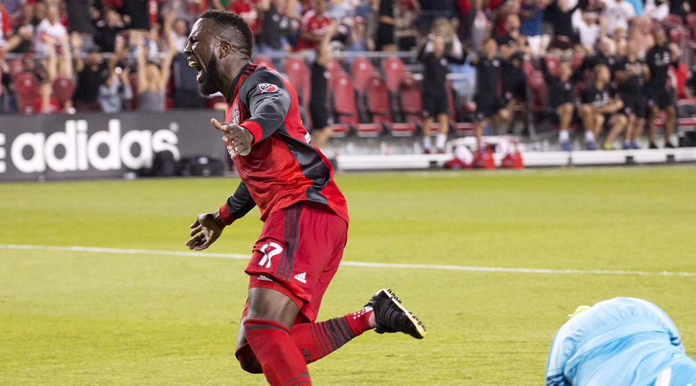 Jozy Altidore celebrating his goal running towarards the supporter's section at BMO Field. Image by Dennis Marciniak of denMAR Media.