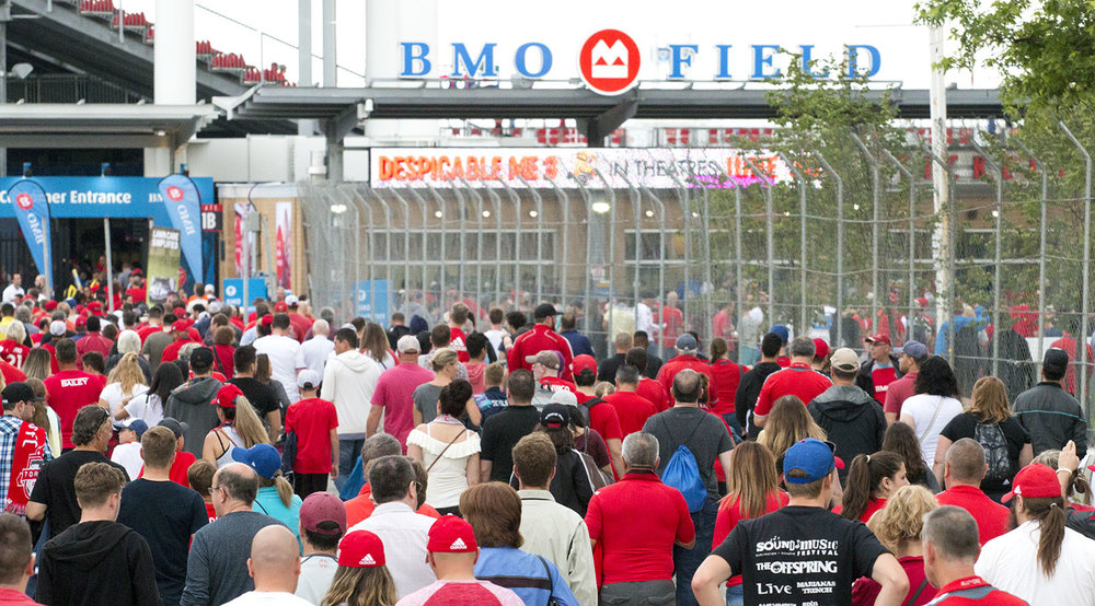 Fans pile into BMO Field on a warm summer night in Toronto for a Toronto FC match against the New England Revolution. Image by Dennis Marciniak of denMAR Media.