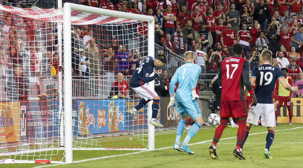 Lee Nguyen heads the ball out of danger and away from the goal line after a Toronto FC free kick. Image by Dennis Marciniak of denMAR Media.